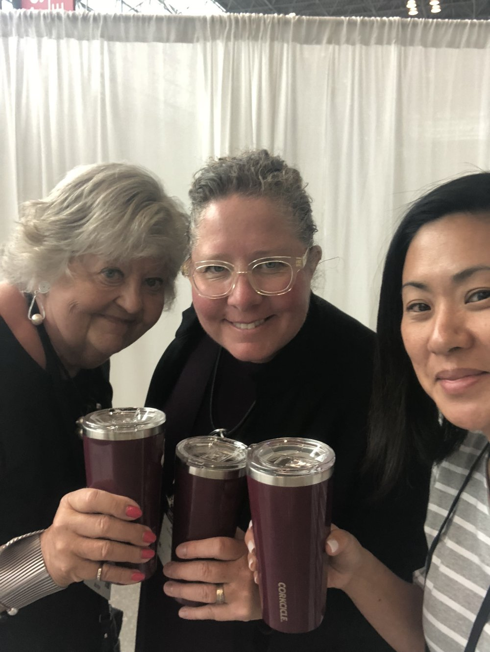 Sandy, with daughters Heather and Melissa, celebrate another successful buying trip at the NY NOW Show in NYC, August 2018.