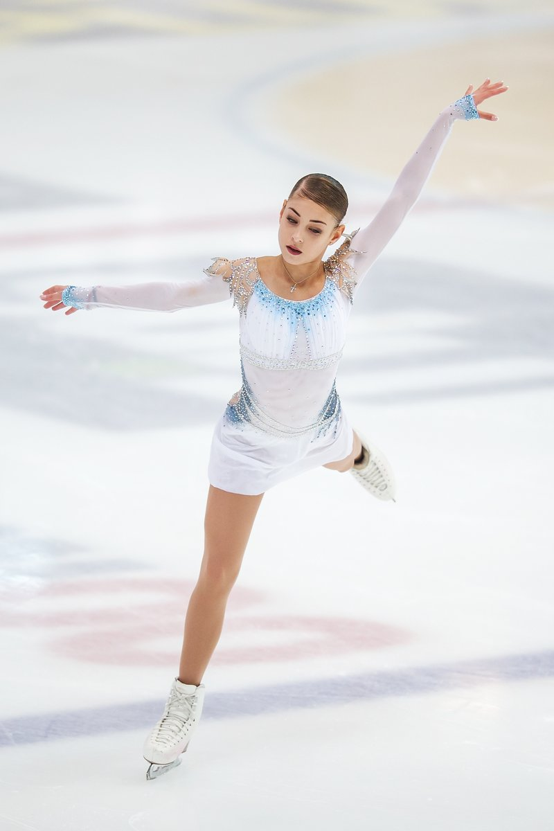 Alena Kostornaia skating her short program at JGP Cup of Austria ( Photo credit ).