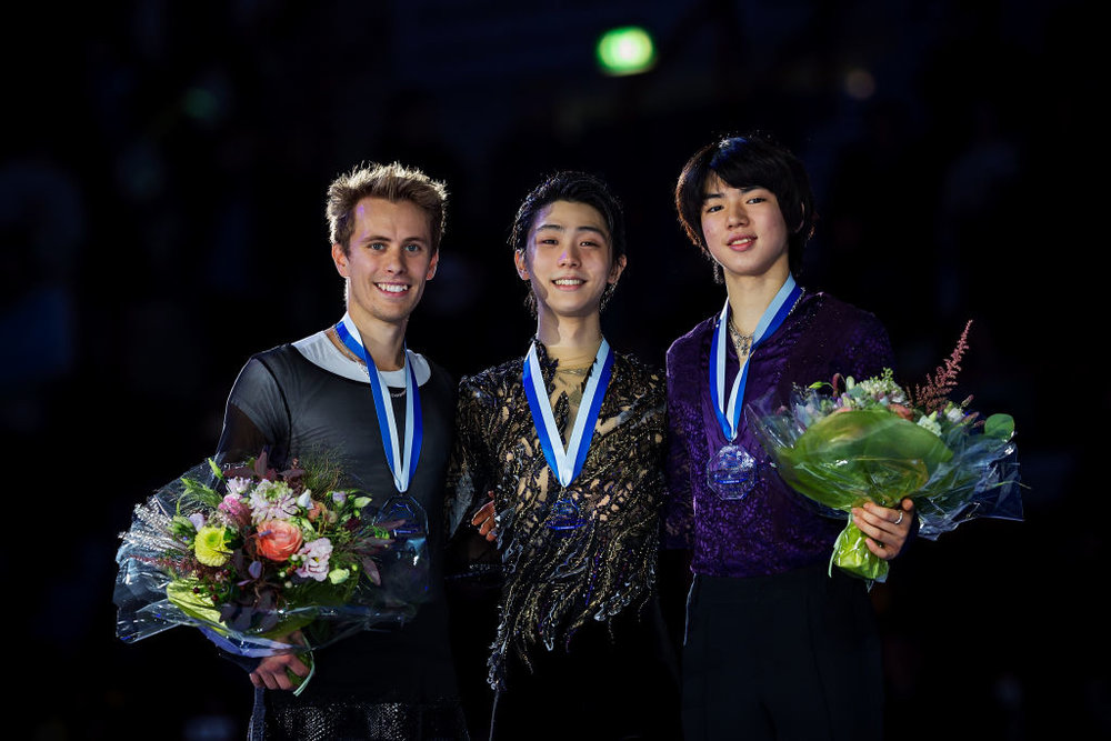 Men's medallists at GP Helsinki pose on the podium (   Photo credit: ISU   )