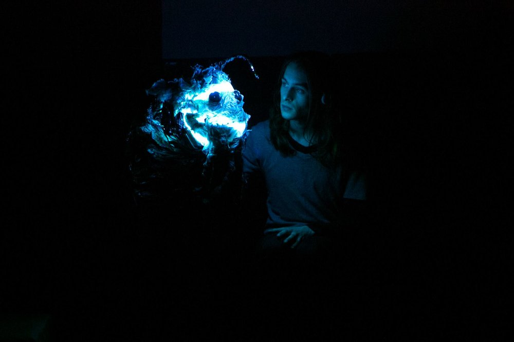 Pictured: Matt Olden in  Pinocchio Restrung ; creature design by Jacinta Anderson and John Collopy; lighting design by John Collopy; photography by Jules Kaddatz.