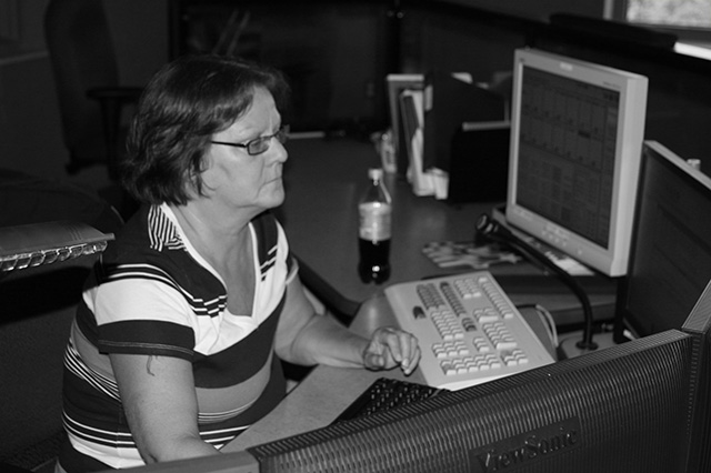 Deb Pallett working in dispatch. Photo by Ricardo Martinez II of Jabber Log
