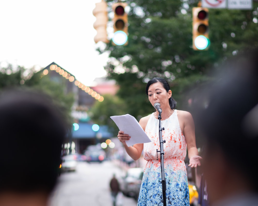 Momo Nakamura performing in   Reflections on Identity   at the Charm City Night Market. Photo courtesy of Corey Jennings.