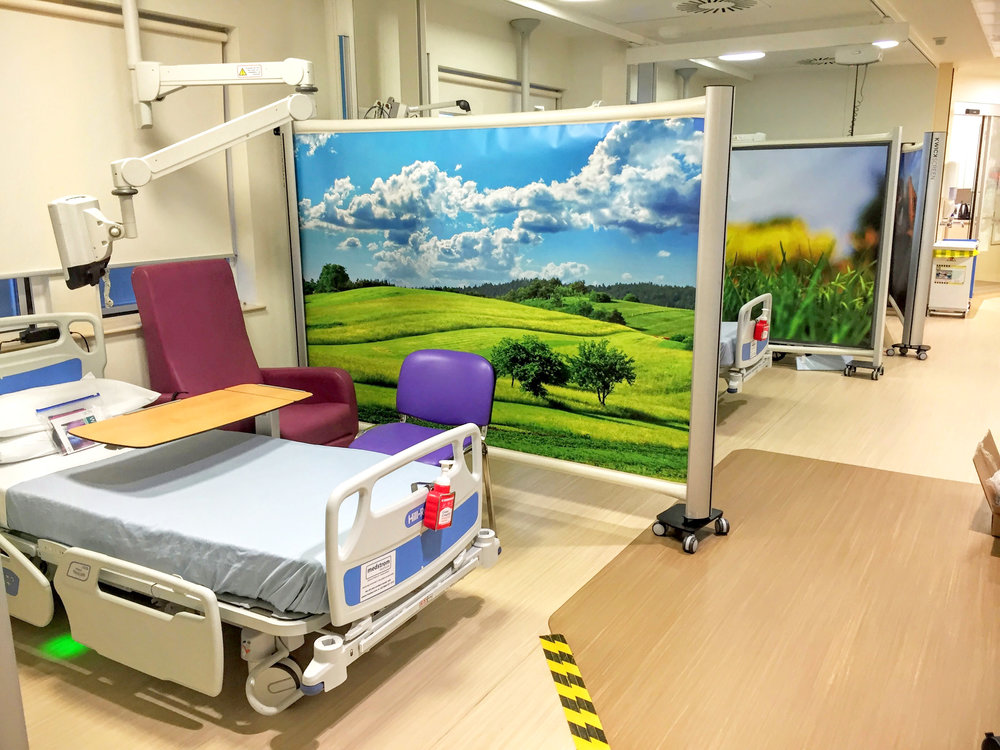 KwickScreen dividing up bays in multiple bed ward in The National Hospital for Neurology and Neurosurgery
