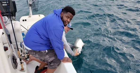 @eryck.johnson.98 put it on his first tarpon. Yesterday morning. Too bad his pops sabotaged the pic 😂 #evinrude #ofishlyhooked#powerpole#boatsnmotors