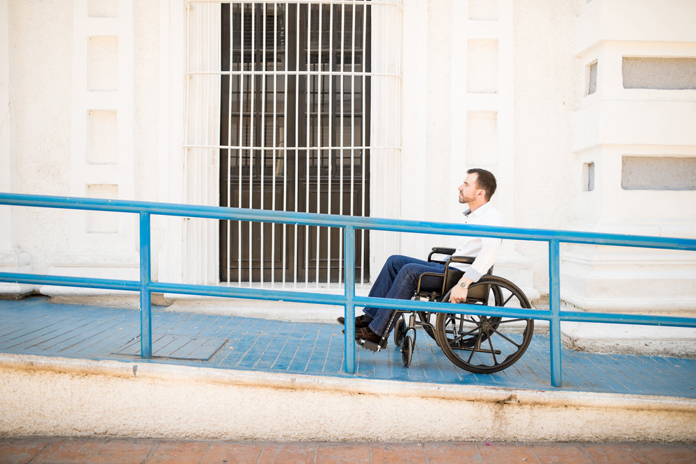 Wheelchair user on a wheelchair accessible ramp.
