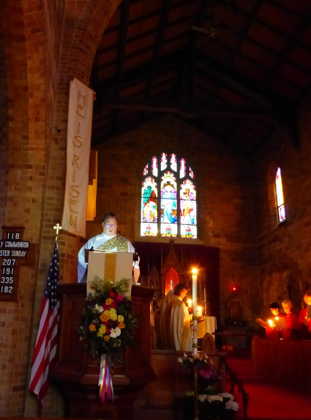 Deacon Don chanting exsultet at Easter Vigil.jpg