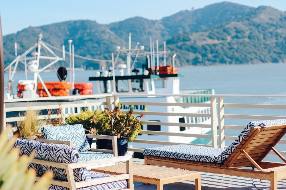 The Grand Waterfront Deck at Waters Edge Hotel is peerrfffect for bayside relaxing.