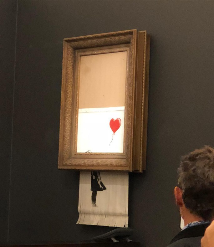 BANKSY'S GIRL WITH RED BALLOON MYSTERIOUSLY SHREDS FOLLOWING ITS SALE AT SOTHEBY'S LONDON. IMAGE COURTESY OF CASTERLINE GOODMAN GALLERY .