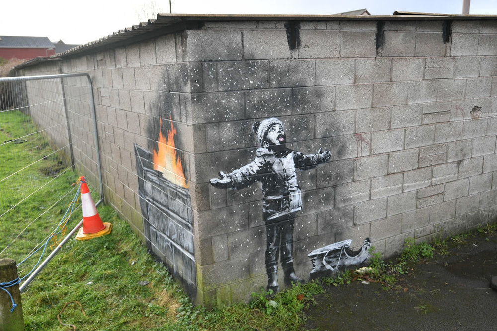 Banksy's latest work. Photo by Ben Birchall/PA Images via Getty Images.