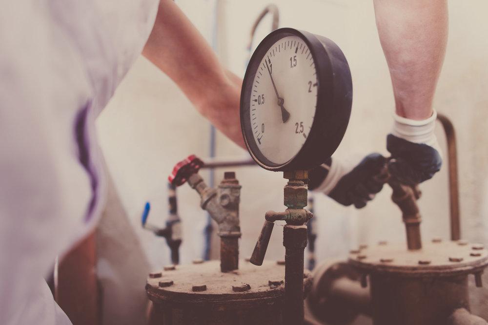 plumber-works-meter-closeup-PJMY43Y.jpg