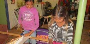 Balgo students try their hand at Silk Screening during Deadly Divas Day.