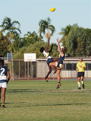 Kimberley Spirit's Gordan Churchill with an impressive leap in the ruck.