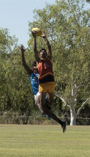 Central Kimberley's Junior Shandley takes a mark.