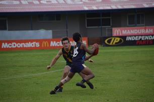 Joharn Jack side stepping a South West Football League opponent.