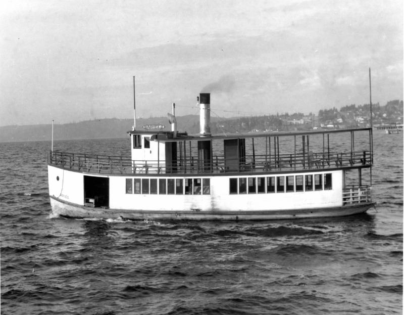 The Ariel operated on a route from Madison Park to Houghton, serving wharfs on Evergreen, Hunts and Yarrow Points. She was owned by the Johnson brothers and was the only steamer on the lake that stayed out of the hands of Captain Anderson. She ended her days serving as student housing on Portage Bay. (Photo courtesy of Puget Sound Maritime)