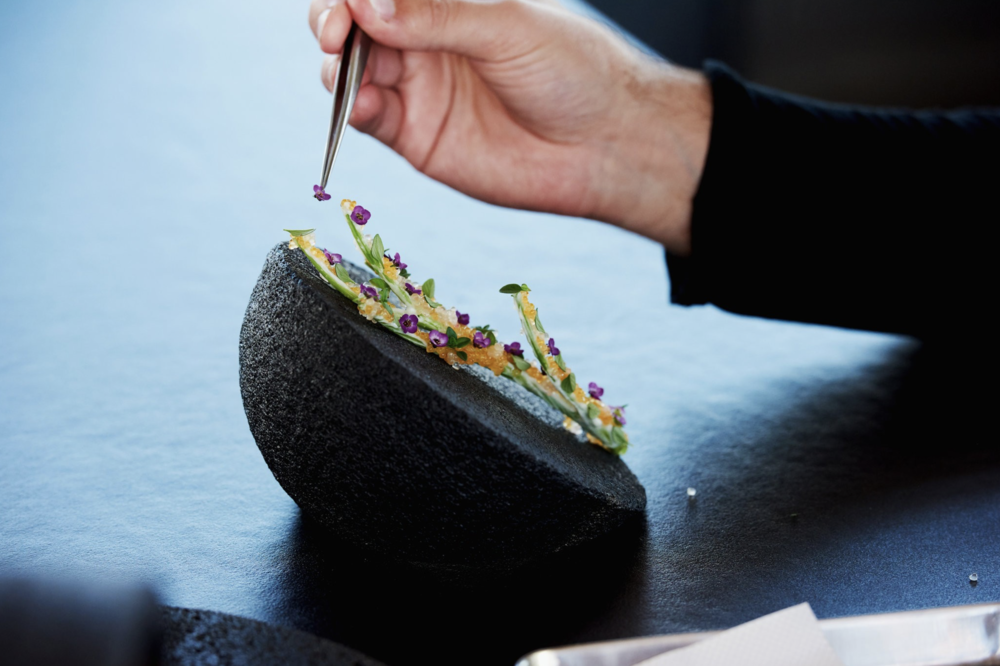A meal at Vespertine may begin with a water spinach stem bedazzled with pike caviar and flowers .Credit Jake Michaels for The New York Times