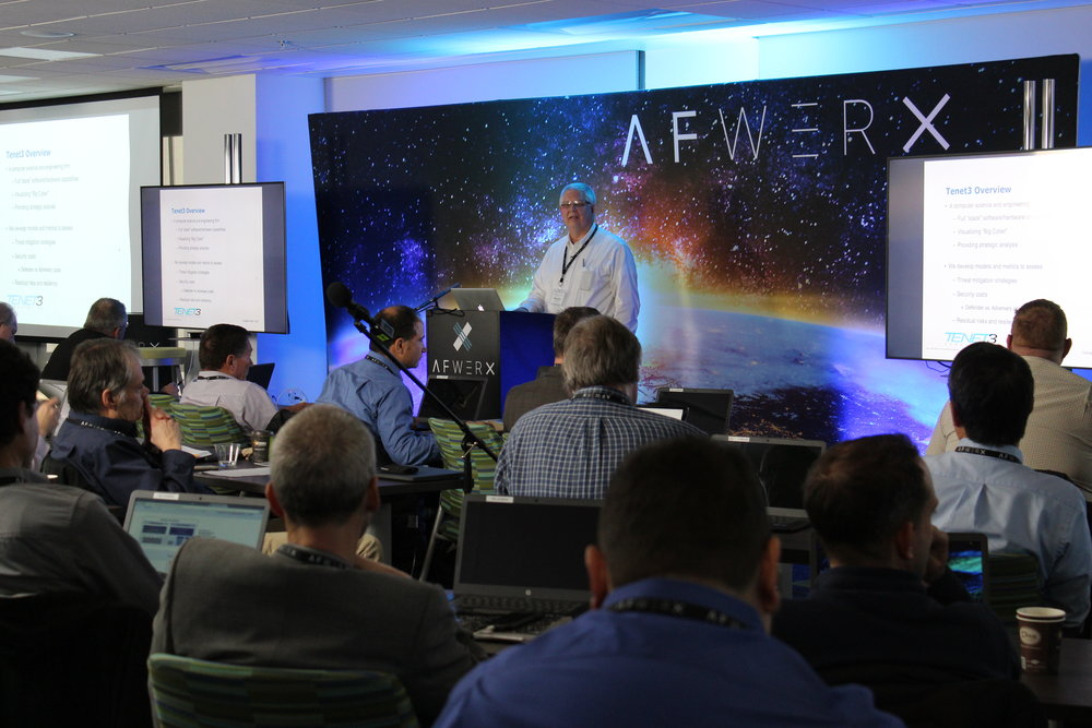 """Jeffrey Dalton, principal data scientist with cybersecurity analyst Tenet3 LLC, Dayton, Ohio, presents information regarding systems analysis software that developers of custom silicon-chip solutions might use. Dalton presented to fellow technologists gathered at the Advanced Microelectronics """"Boot Camp"""" Dec. 4-5, 2018 at the dedicated AFWERX Vegas Innovations Hub, Las Vegas. PHOTO: AFWERX"""