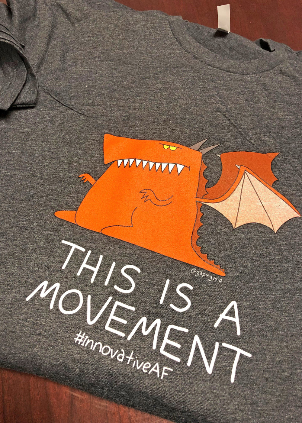 """The """"Feed the Dragon"""" campaign features non-traditional tools such as """"Innovation Culture Walls,"""" T-shirts featuring """"Eddie the Dragon,"""" stickers, and catchy social media hashtags. U.S. Air Force photo by Kenji Thuloweit"""