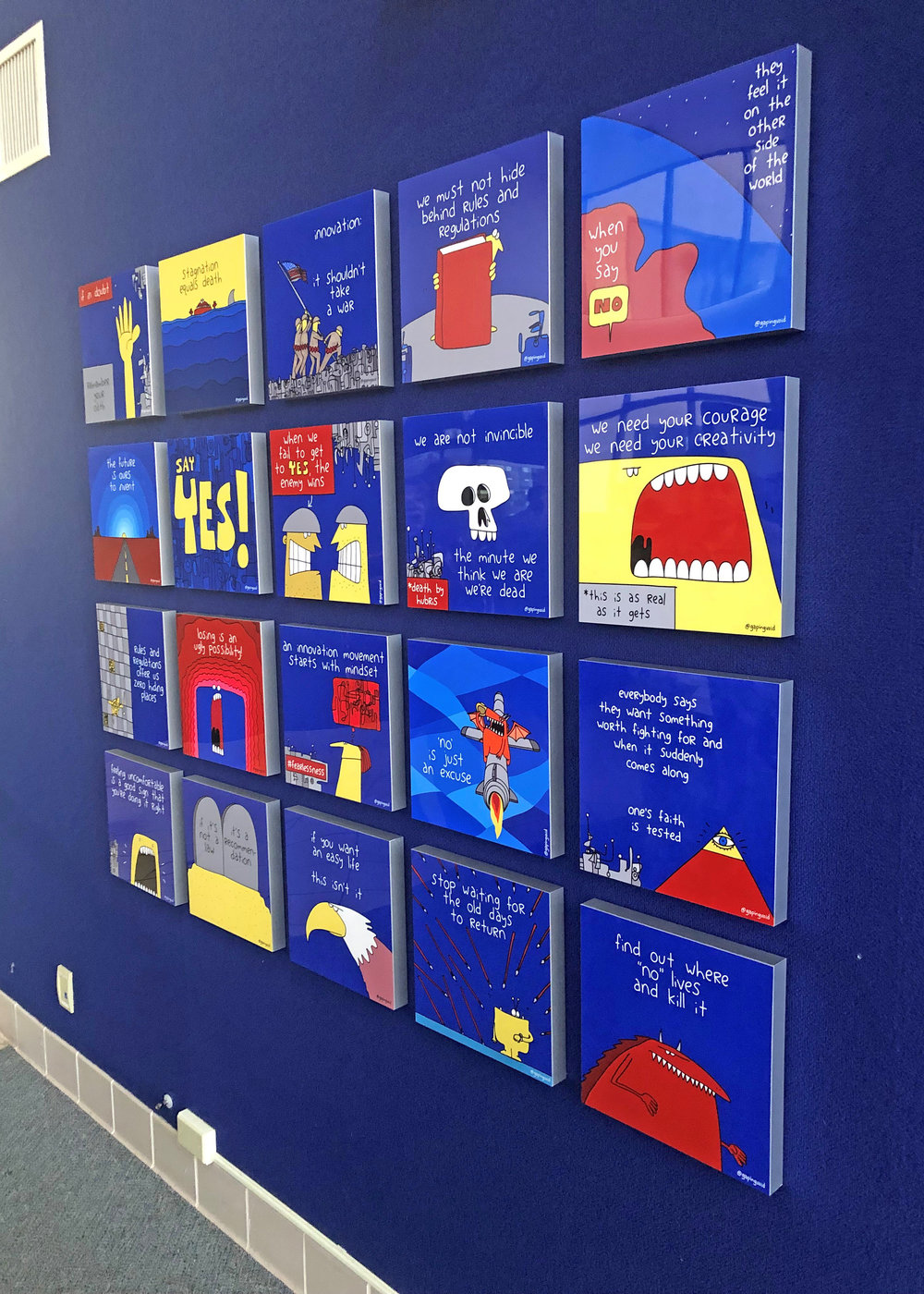 """One of 25 planned art installations across the base, an """"Innovation Culture Wall"""" was revealed to attendees of a """"Feed the Dragon"""" campaign roadshow at Edwards AFB Jan. 15, 2019. Developed with the assistance of  Gapingvoid Culture Design Group , the wall presents messages of values and purpose, such as, """"We must not hide behind rules and regulations"""" and """"'No' is just an excuse."""" U.S. Air Force photo by Kenji Thuloweit"""