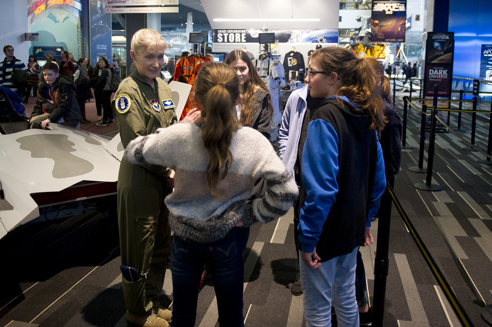 U.S. Air Force Brig. Gen. Jeannie M. Leavitt, Air Force Recruiting Service commander, left, speaks with students during a Science, Technology, Engineering, and Mathematics (STEM) fair at the Smithsonian National Air and Space Museum, Washington D.C., March 7, 2019. The event coincided with a screening of a new superhero movie. Photo: U.S. Air Force Master Sgt. Michael B. Keller