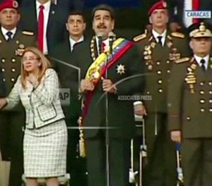 On August 4, 2018, Venezuelan President Nicolas Maduro delivered a speech at an event celebrating the country's national guard when two drones carrying plastic explosives exploded nearby. (Venezolana de Television via AP)