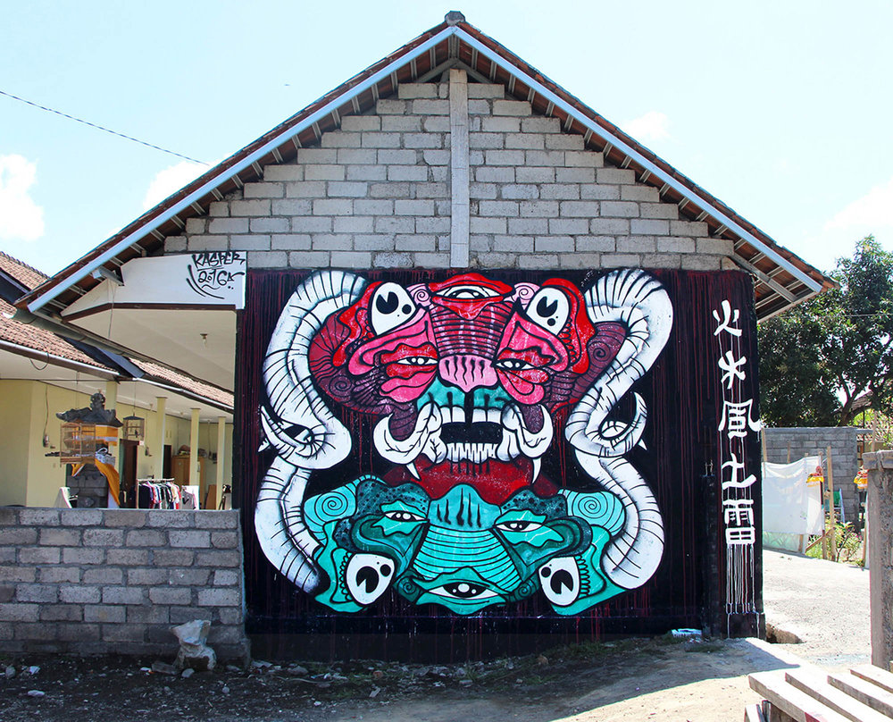 Mural painted in Bali, Indonesia on traditional housing complex