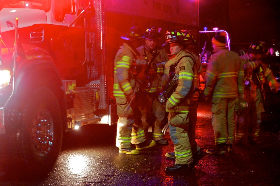 Westwood, NJ - March 7, 2011: Local firefighters prepare to assist residents of flooded homes after heavy rains and an opened flood gate cause a late-night flood.