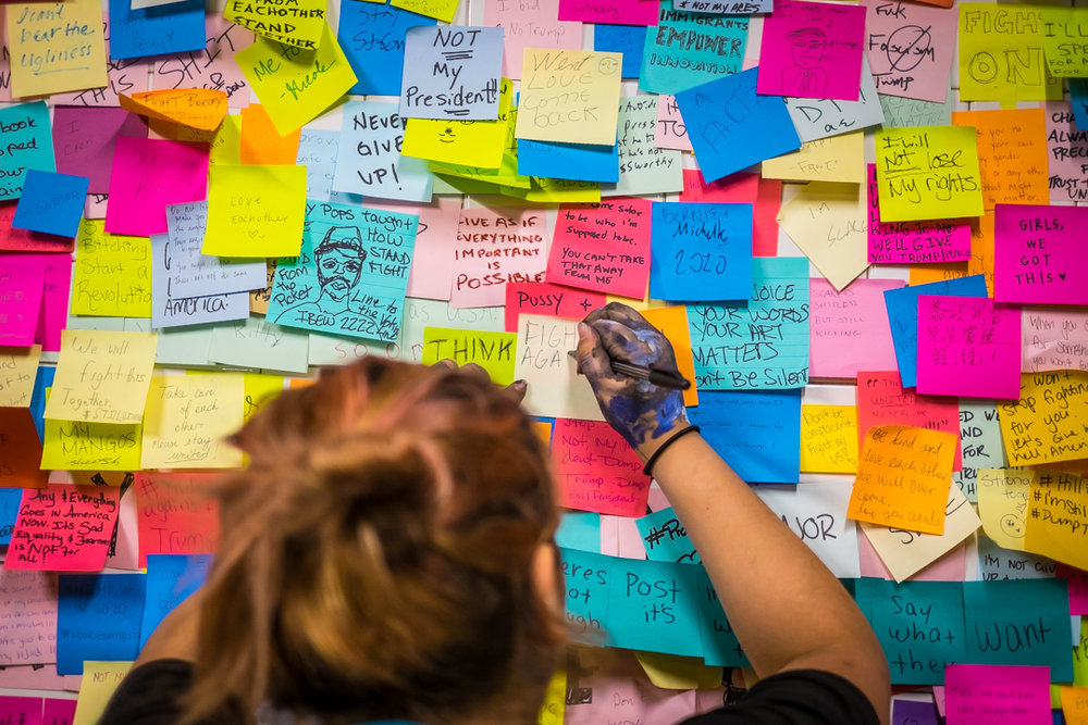 New York, NY - Nov. 16, 2016:  Subway riders cover a wall in the Union Square subway station with post-its in response to the Presidential election of Donald Trump.