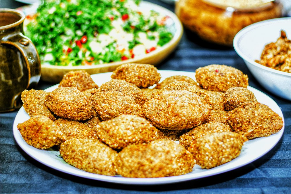 Kibbeh Mseloua'at;  Ground Lamb & broken wheat meatballs in a spicy red pepper and lemon sauce (a traditional Syrian dish made during celebrations)