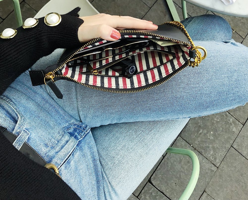 - THE QUATTRO BAG HAS THE CLASSIC STRIPED LINING