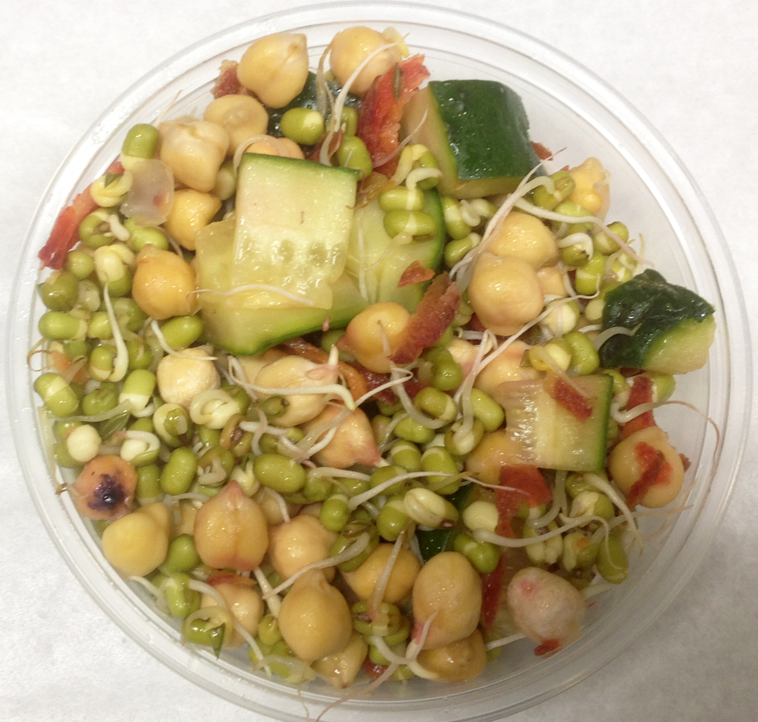 Sprouted mung beans and chickpeas, colorful heirloom carrots, cucumbers with a citrus dressing.