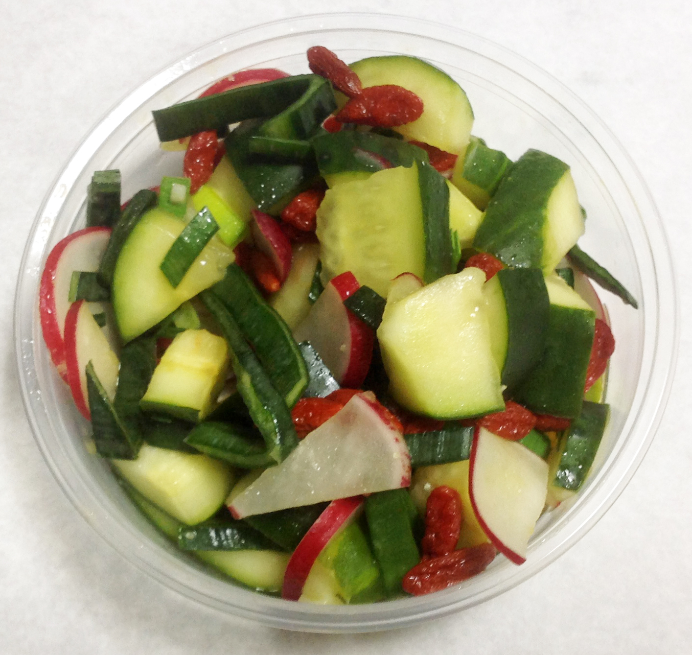 Cucumber, red radish, goji berries and leeks with an orange citrus dressing.
