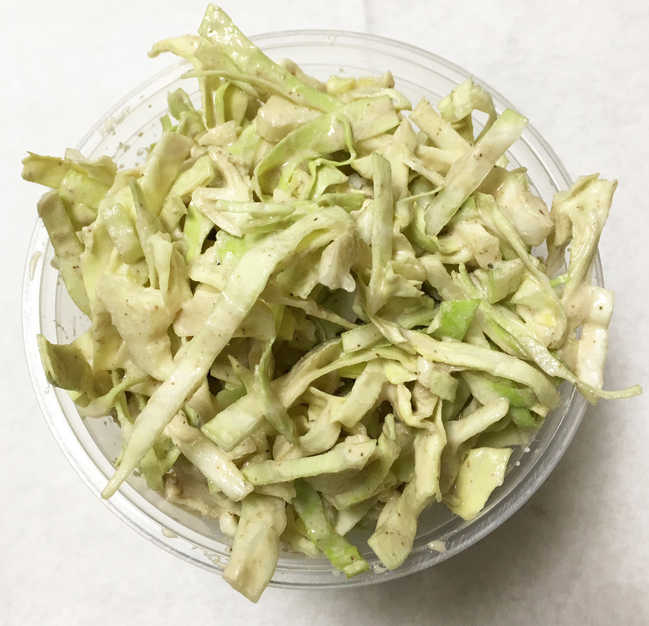 Green cabbage and celery coleslaw with a creamy walnut dressing.