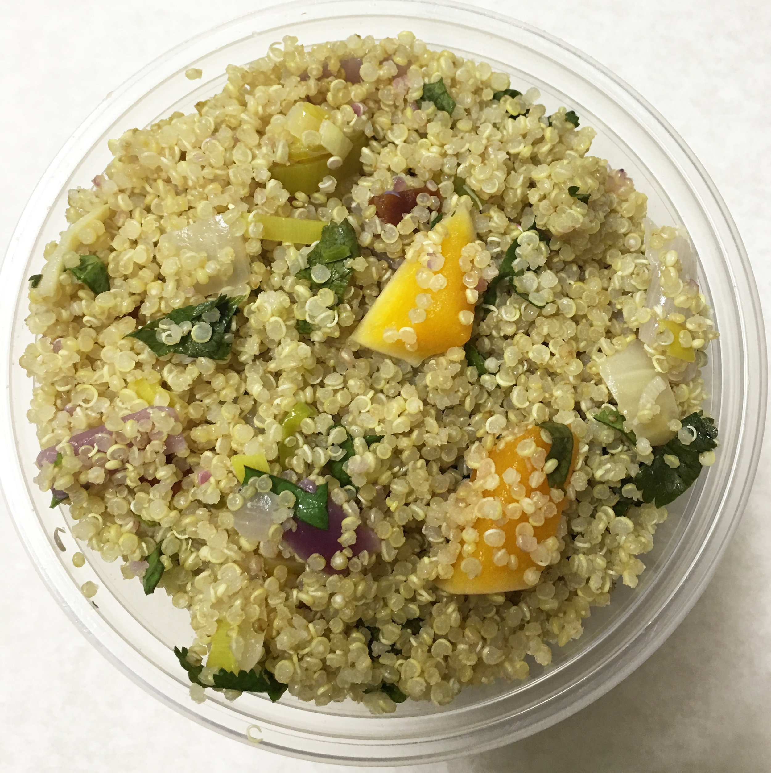Quinoa salad with butternut squash, onion and parsley.