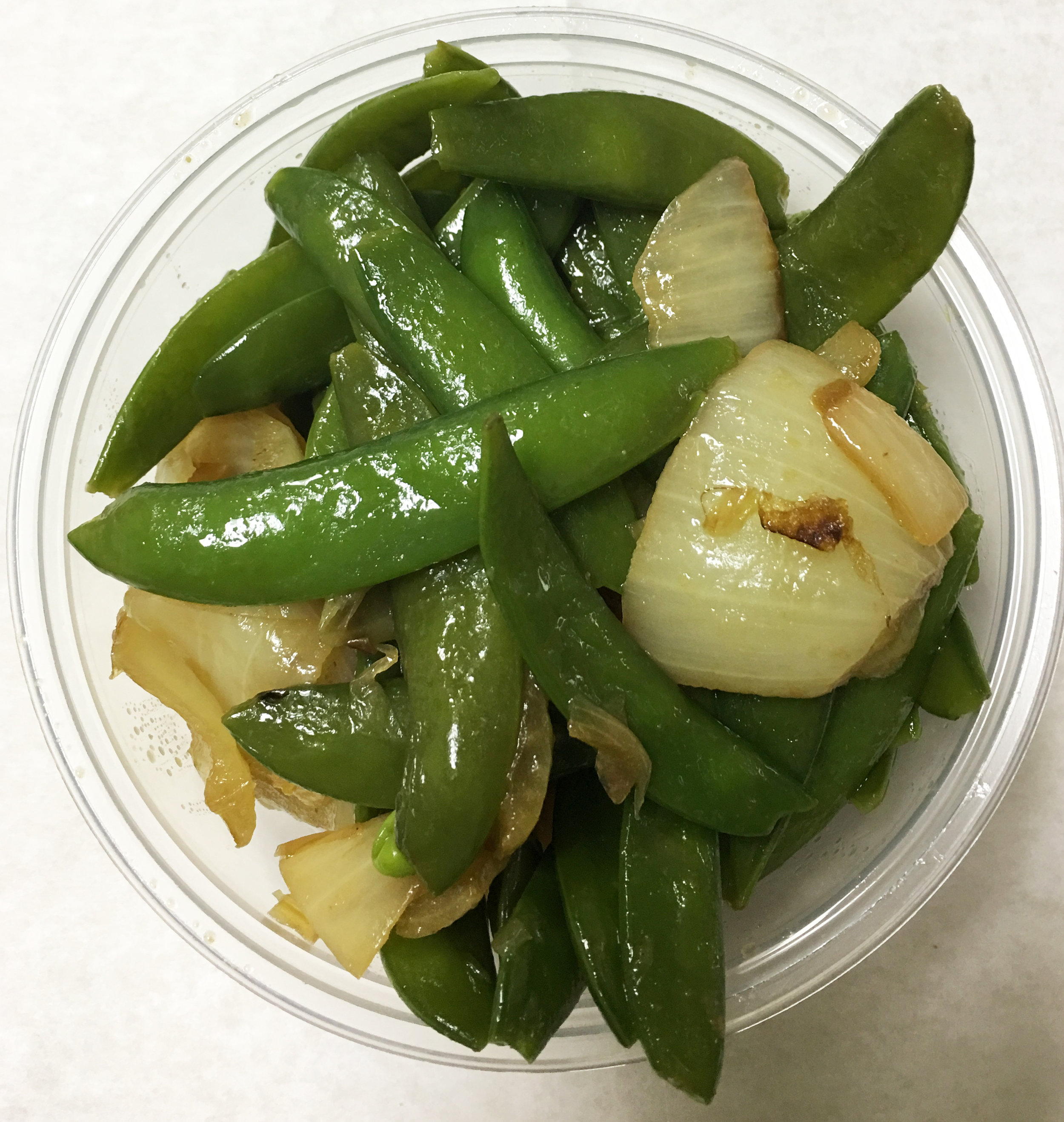 Sauteed snap peas with onions and a mustard marinade.