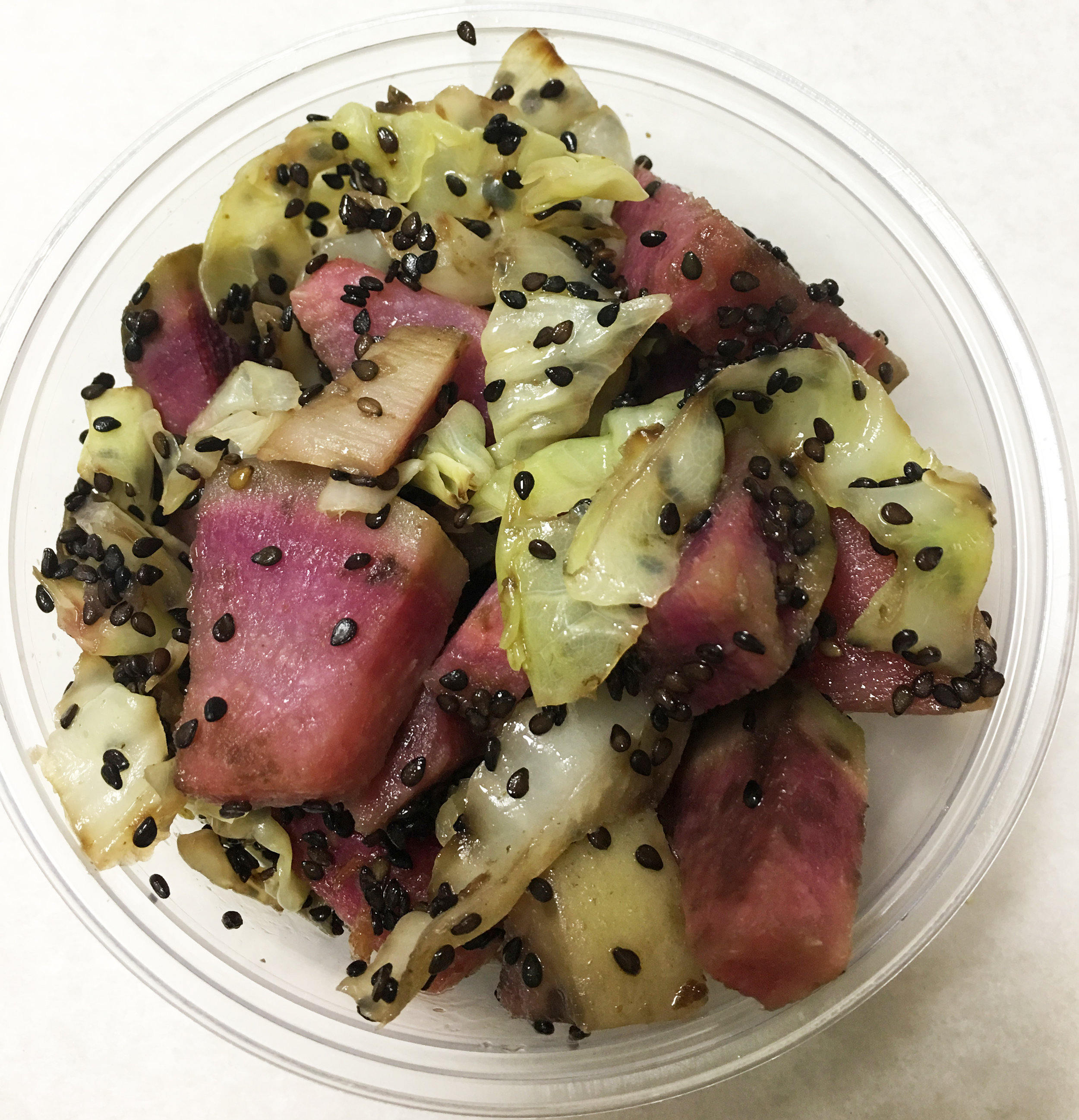 Boiled salad of watermelon radish, green cabbage and black sesame seeds.