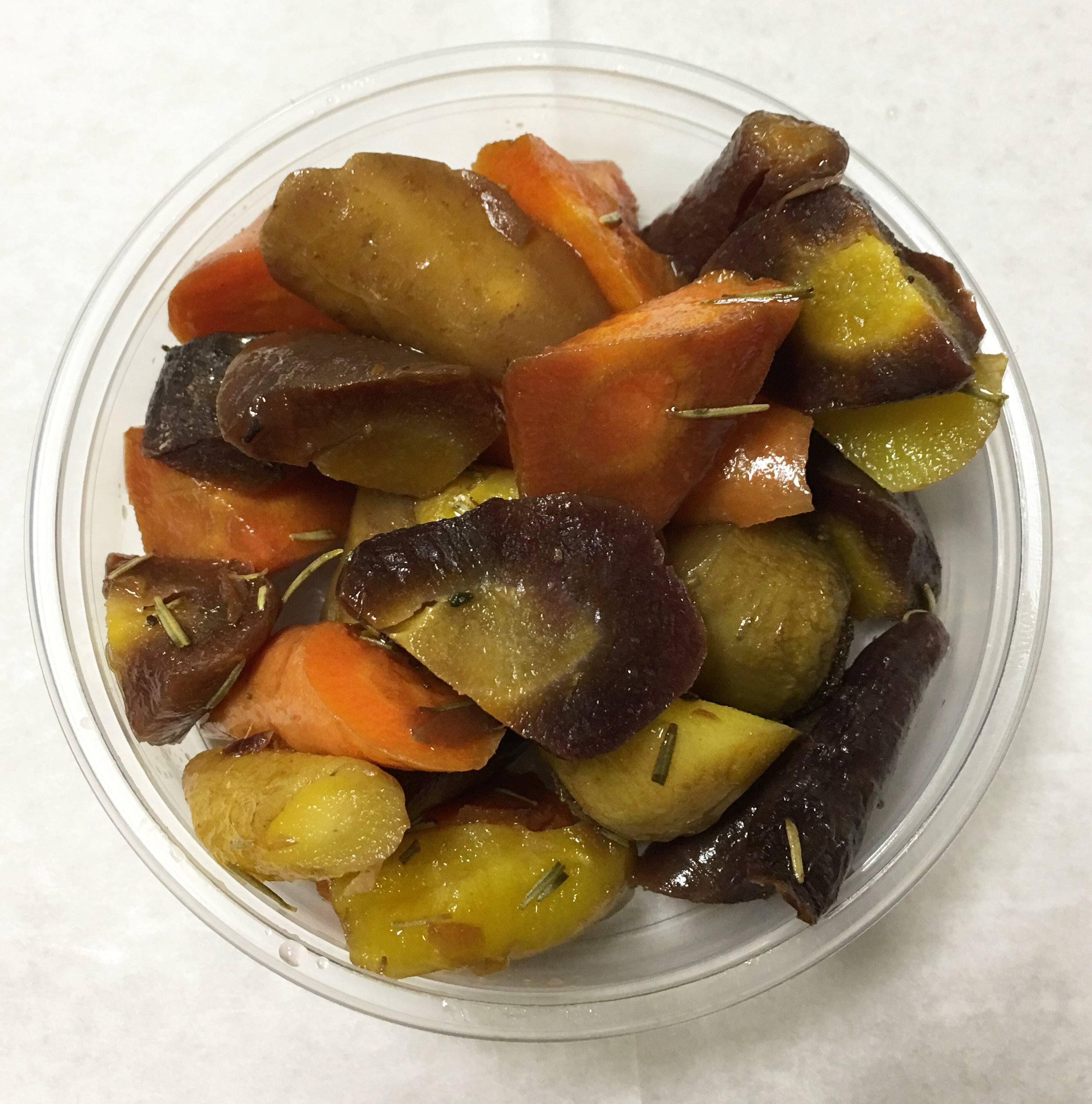Baked colorful heirloom carrots with rosemary.