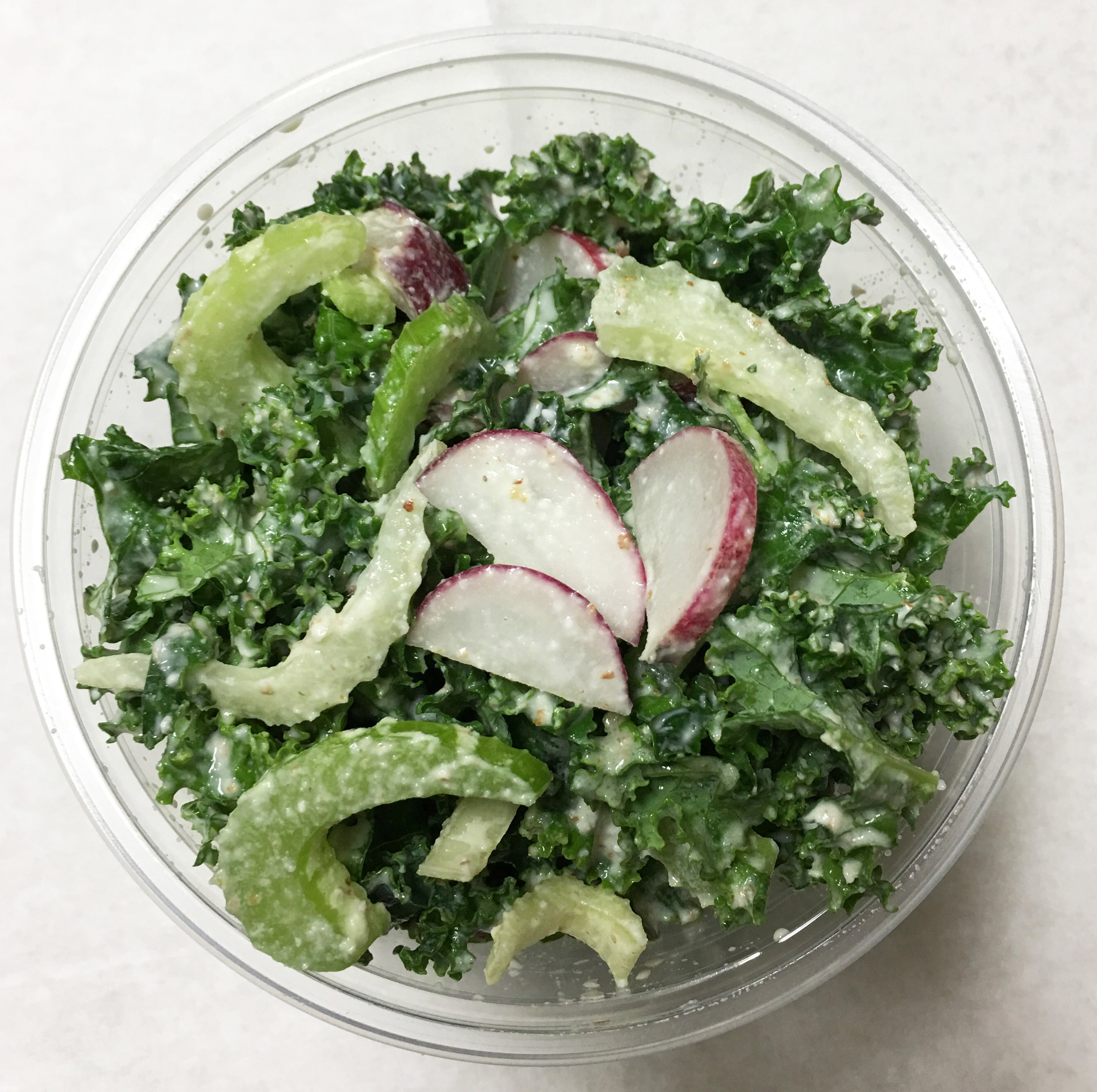 Curly kale salad with red radish, celery and almond cream dressing. (Please note since the dressing this week is already on the salad you will not receive a separate container of dressing.)