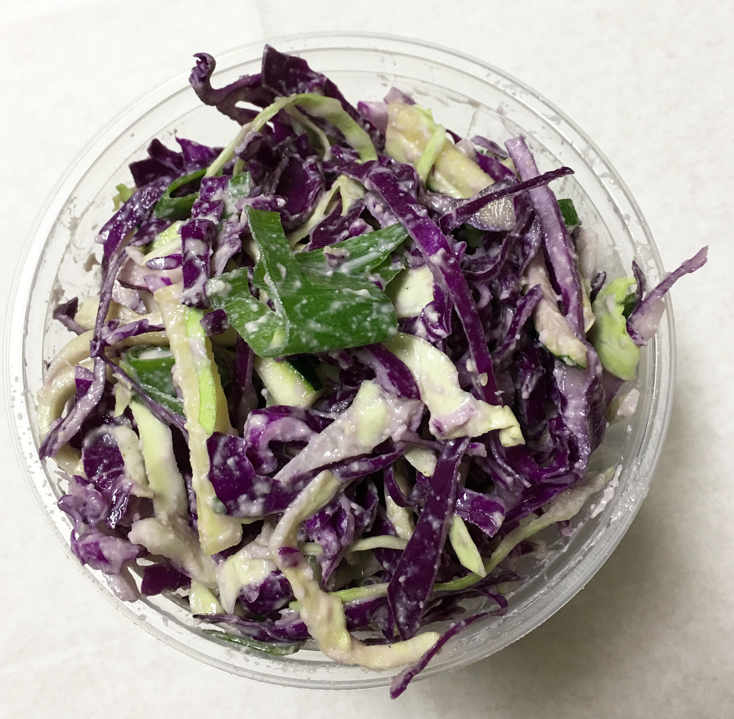 Red and green cabbage coleslaw with zucchini and a mustard sesame seed dressing.