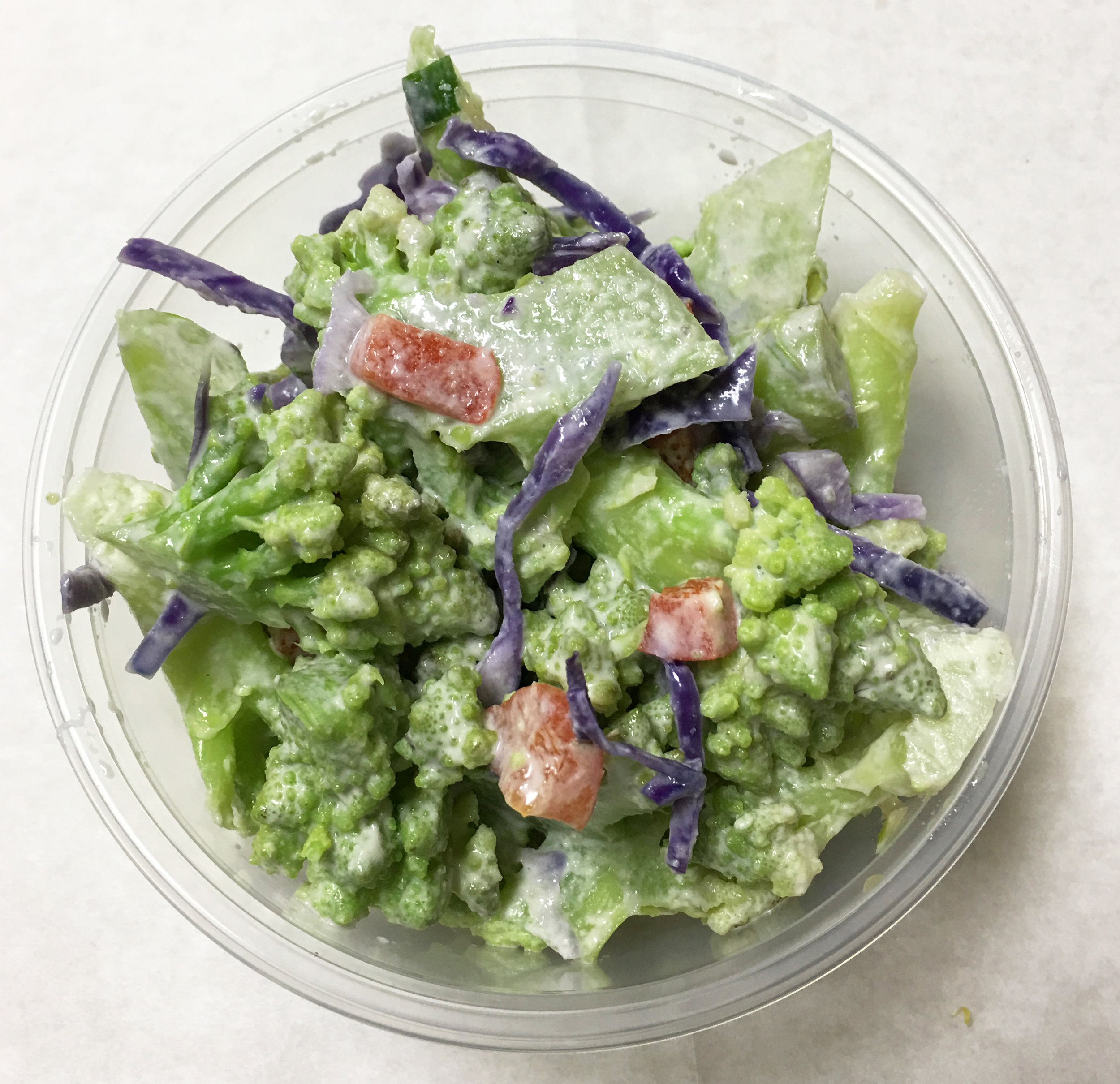 Boiled salad of Romanesco broccoli, red cabbage, and red bell peppers with a garlic tahini dressing.