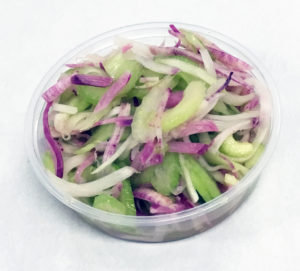 Purple radish, celery and scallions marinated in a fresh squeezed mandarin juice dressing.