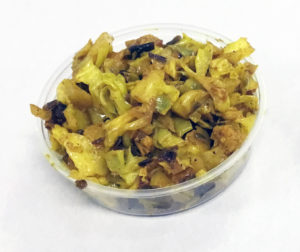 Stir fried green cabbage, cauliflower, raisins, turmeric and black pepper.
