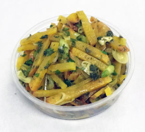 Golden beet boiled salad with scallions and parsley.
