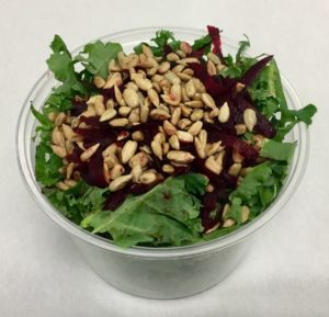 Kale with shredded beets and roasted sunflower seeds.