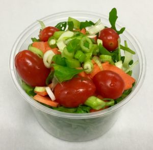Arugula with carrot, grape tomatoes and scallions