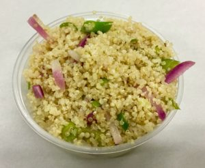 Quinoa with red radish, celery, scallion and an apple cider vinegar dressing.