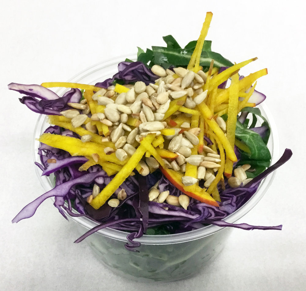 Collard greens, red cabbage, golden beets and roasted sunflower seeds.