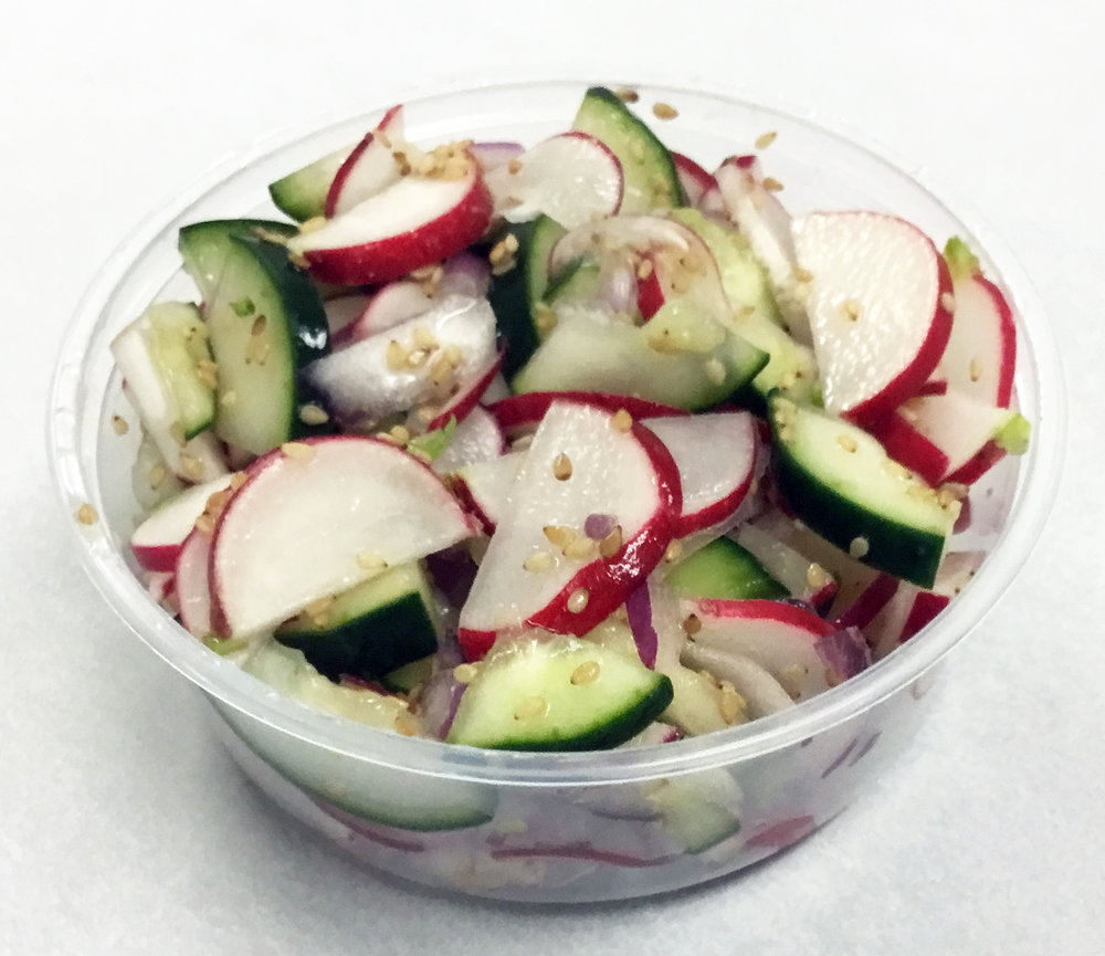 Red radish, cucumber and toasted sesame seed pressed salad.