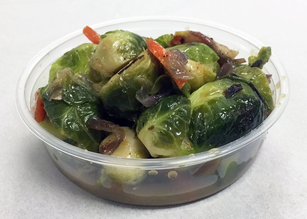 Brussel sprouts with red onion, carrot, brown rice syrup and black pepper.