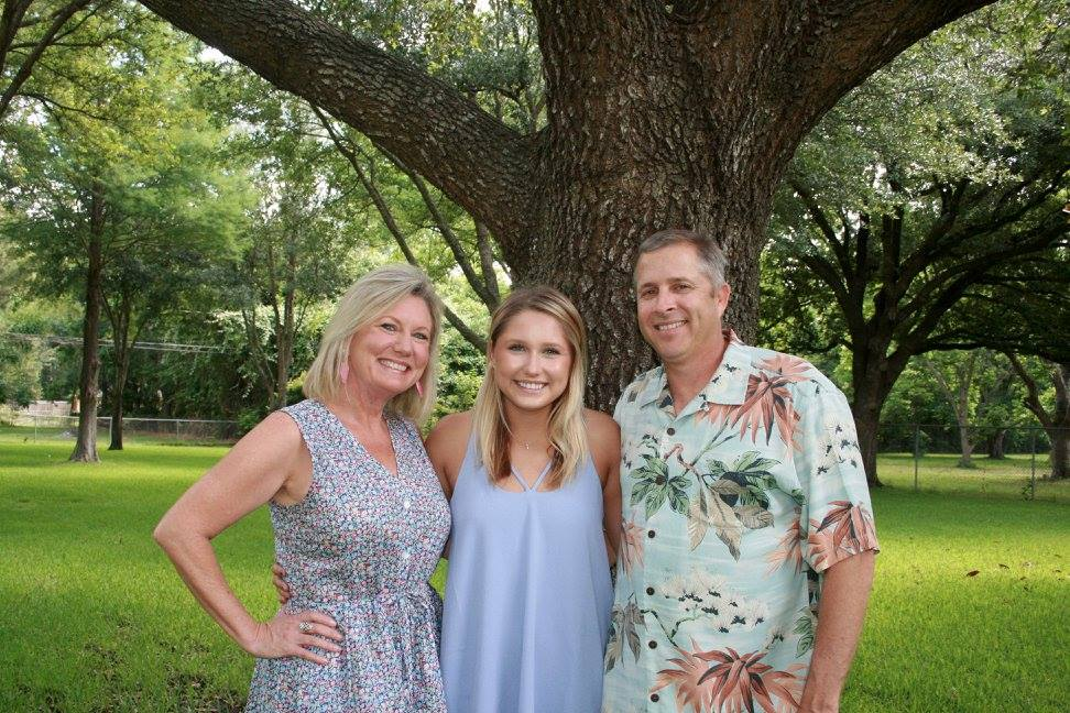 Randy Fuller, the owner of Yardmasters, Inc., with his wife and daughter.